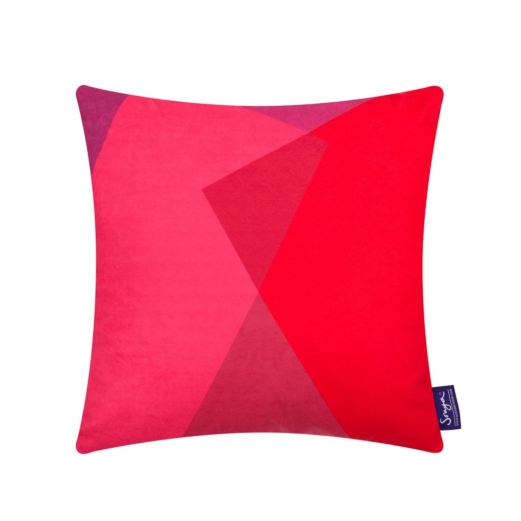 A cropped detail image of the modern Sonya Winner After Matisse Boudoir cushion, showcasing the bright pink and red colours, graphic pattern and rich faux suede texture