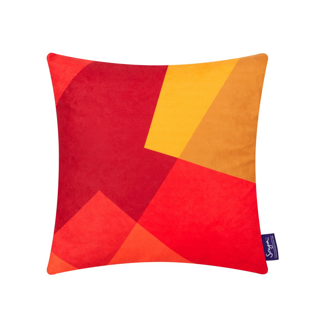 A cropped detail image of the modern Sonya Winner After Matisse Fire cushion, showcasing the bright red and yellow colours, geometric pattern and rich faux suede texture