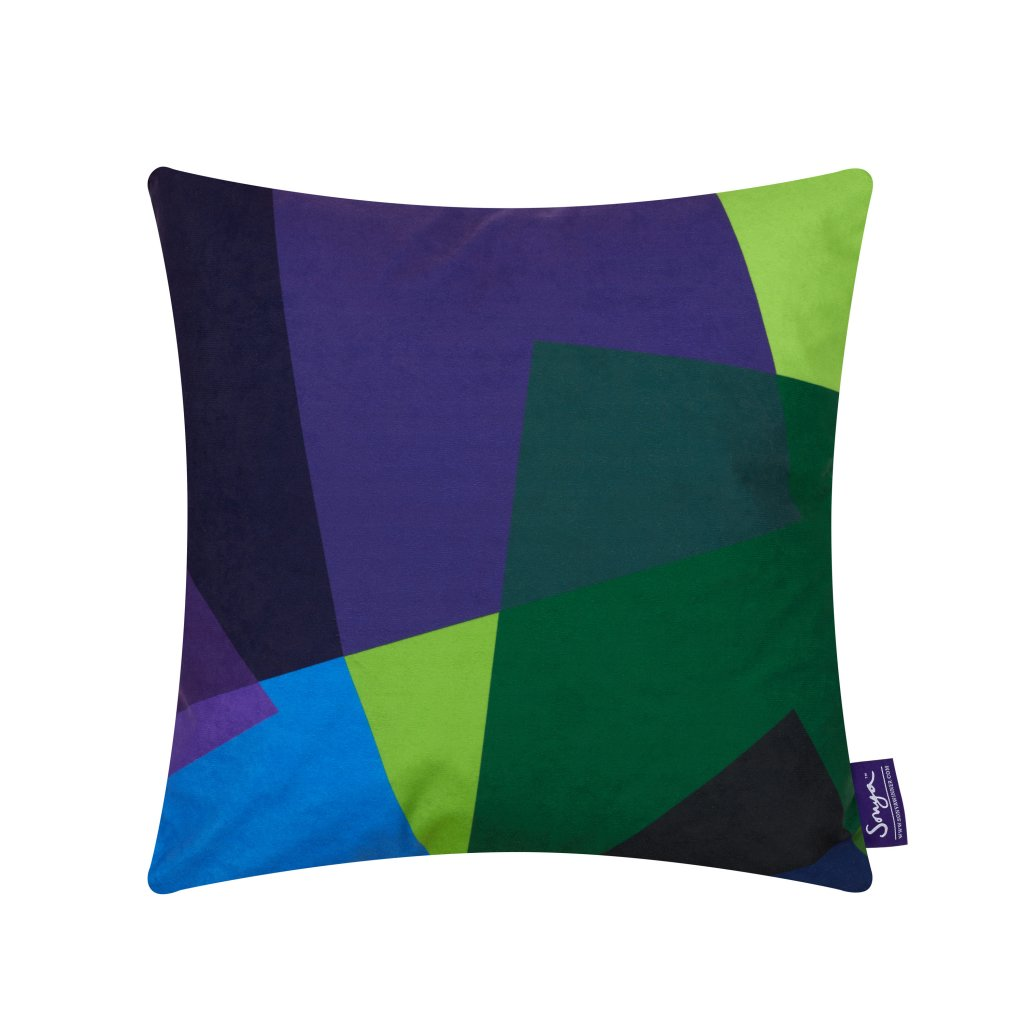 A cropped detail image of the unusual Sonya Winner After Matisse Green and Blue cushion, showcasing the deep blue, green and purple colours, irregular pattern and rich faux suede texture